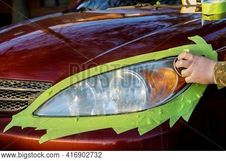 Headlight Restore In The Worker Polishes Optics Of Headlights Of The Car With The Hand Tool At Car S