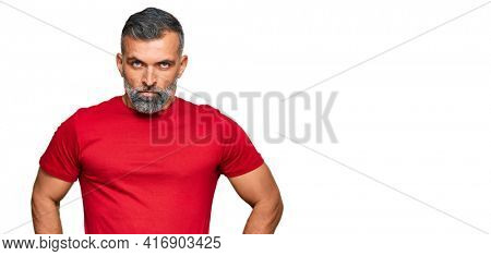 Middle age handsome man wearing casual clothes skeptic and nervous, frowning upset because of problem. negative person.