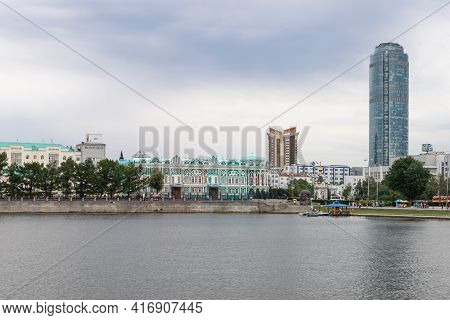 Embankment Of City With Buildings Of Ural State University Of Architecture And High Tower Of Busines