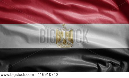Egyptian Flag Waving In The Wind. Close Up Of Egypt Banner Blowing Soft Silk.
