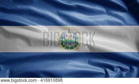Salvadorean Flag Waving In The Wind. Close Up Salvador Banner Blowing Soft Silk.