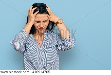 Young caucasian woman wearing casual clothes suffering from headache desperate and stressed because pain and migraine. hands on head.