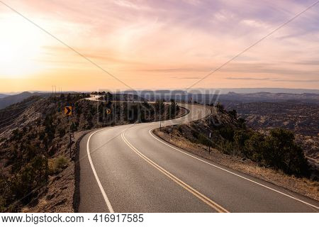 View Of A Scenic Route On Top Of A Mountain Ridge In The Desert. Colorul Sunset Sky Art Render. Take