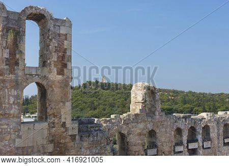 Ancient Odeon Of Herodes Atticus Roman Theater Under The Ruins Of Acropolis, With View Over The City