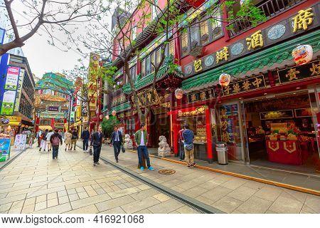 Yokohama, Japan - April 21, 2017: Asian People Walking In Yokohama Chinatown Pedestrian Street Area.