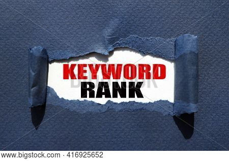 Keyword Rank. Text On White Paper Over Torn Paper Background.