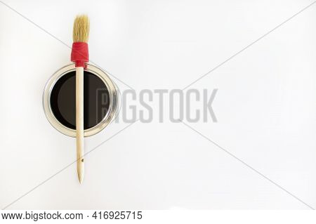 Paint Symbol. A Round Paint Brush Lies On A Can Of Paint On A White Background. Copy Space. Business