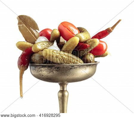 Preserved Vegetables In Old Brass Dish Isolated On A White Backgroud. Marinated Cucumbers, Tomatoes,