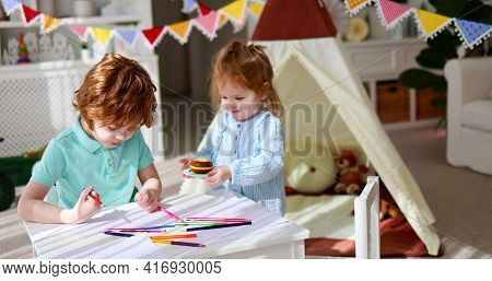 Cute Siblings, Friends Playing Together At The Playroom At Home