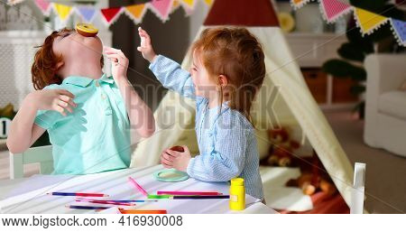 Cute Siblings, Friends Playing Together At The Playroom At Home, Having Fun Together