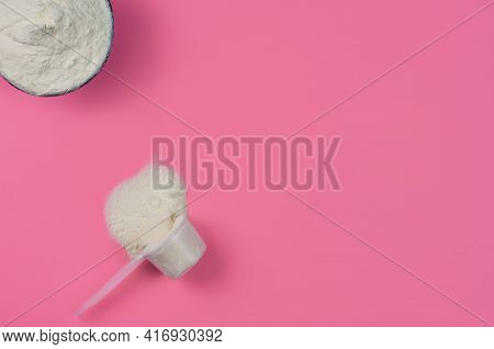 Collagen Powder In Measuring Cup On Red Background , Top View With Copy Space. Protein Intake, Natur
