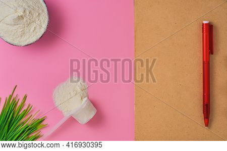 Collagen Powder On Red Background, Top View With Copy Space. Notebook For Keeping Track Of Protein I