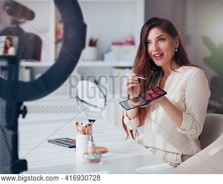 Beautiful Young Woman Streaming A Beauty Vlog From Home, Online Content Creator Applying A Makeup On