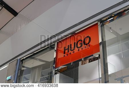 Moscow Russia - April 10 2021:the Logo Of The Famous Brand Hugo Boss Above The Entrance To The Fashi