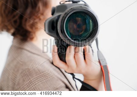 Professional Slr Camera In Womens Hands. Fascination With Photography