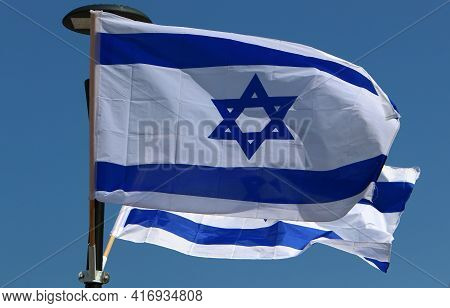 White And Blue Flags Of Israel With The Star Of David Adorn City Streets On Israel\'s Independence D