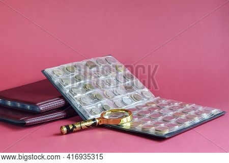 Сoins Are Arranged In Transparent Blisters On Pink Background. Page From Album Full With Old Coins.