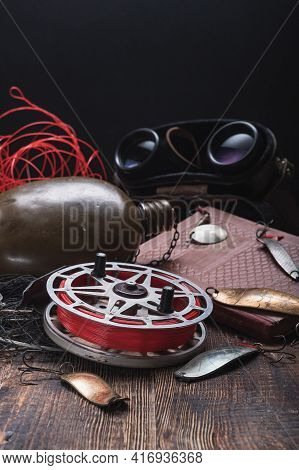 Old Soviet Fishing Reel And Fishing Tackle. Fishing Book And Tackle.