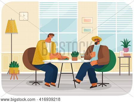 Friends Or Business Partners Sitting In Cafe Or Restaurant At Table Eating And Drinking, Have Dinner