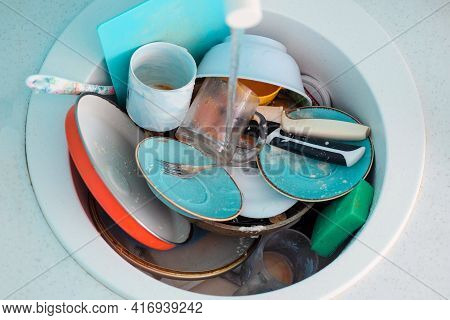 Sink With A Pile Of Dirty Dishes. Complete Washing Of Crockery, Tableware. Unsanitary Conditions.