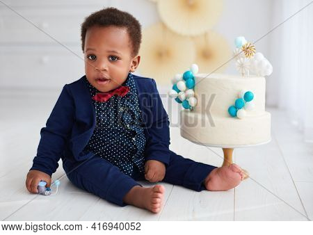 Cute One Year Old Baby Boy With A Birthday Cake