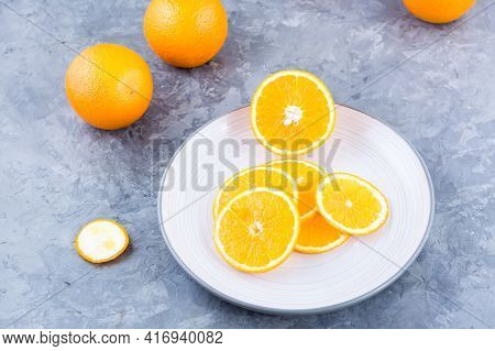 Pieces Of Fresh Orange On A Plate On The Table. Vitamins, Diet And Vigor. Healthy Eating