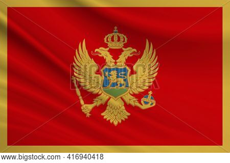 Flag Of Montenegro. Fabric Texture Of The Flag Of Montenegro.