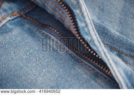 An Unzipped Zipper On A Pair Of Jeans. Close Up.