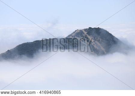 Stratus Clouds Surrounding A Mountain Ridge Taken Above The California Coast In The San Gabriel Moun