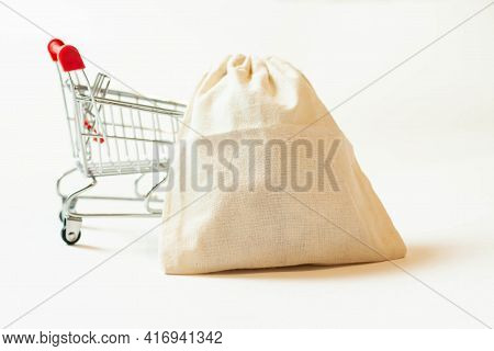 Cash Knitted Bag Applications On A Metal Trolley For Stock Purchases.