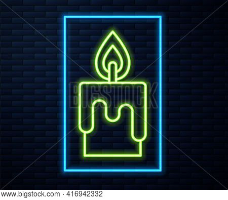 Glowing Neon Line Burning Candle Icon Isolated On Brick Wall Background. Cylindrical Candle Stick Wi