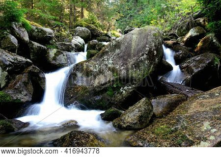 Mountain Stream And Waterfall In The High Tatras National Park In Slovakia