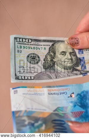Detail Of 100 Usd Banknotes Next To 100 Chf Banknotes. Detail Of United States Dollar And Swiss Fran