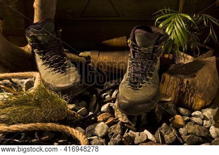 Boots On Stones. Hiking Boots On Stones. Military Boots With Sleeves. Front View.