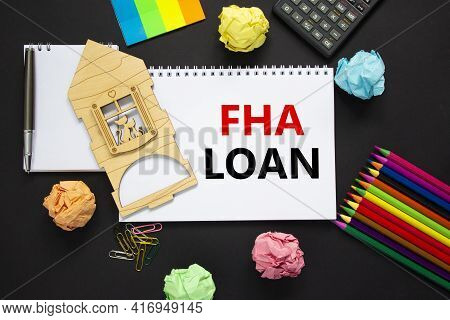Fha Federal Housing Administration Loan Symbol. White Note With Words 'fha Loan' On Beautiful Black