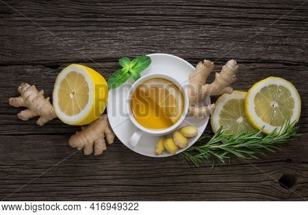 Fresh Healthy Ginger Tea Ginger And Ripe Lemon With Green Mint And Rosemary On A Wooden Background T