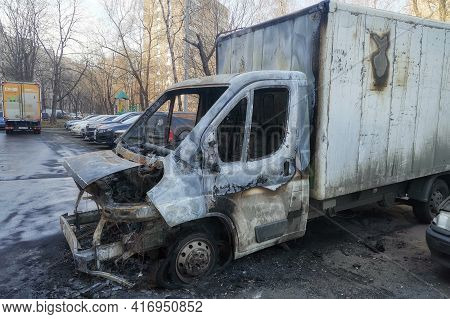 Moscow, Russia - April 14, 2021: Burnt-out Car In A Parking Lot On A Moscow Street.