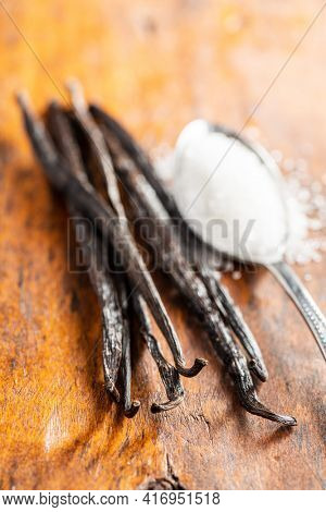 Vanilla pods. Sticks of vanilla with white sugar.
