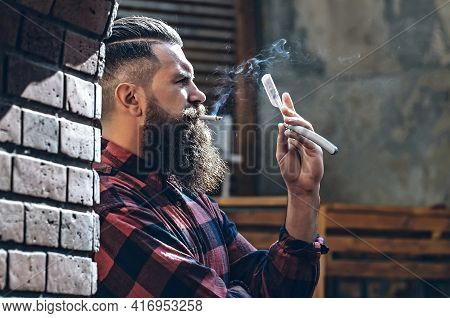 Hipster With Cigarette And Razor. Barber Scissors And Straight Razor, Barber Shop, Suit. Vintage Bar