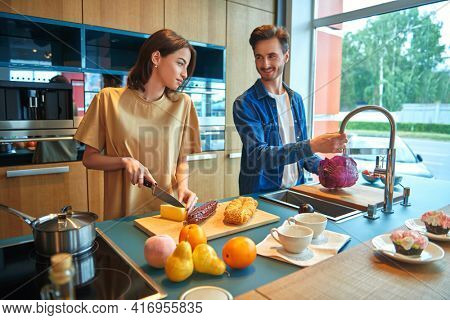 Young people prepare a romantic breakfast together at home in the kitchen. Happy family concept. Home interior, furniture.