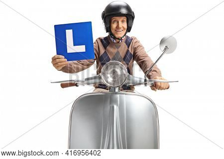 Elderly man riding a vintage silver scooter and holding a learner plate isolated on white background