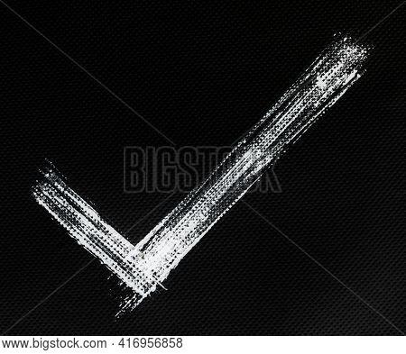 White check mark symbol, hand drawn lines, on black background - Napkin tissue texture