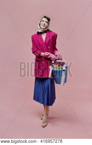 A Stylish Young Woman Holds A Bucket Of Cleaning Tools In Her Hands, Full-length