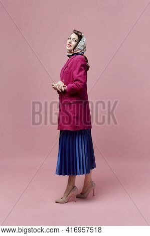 A Beautiful Woman In A Pink Jacket And A Long Full-length Skirt. Pin-up Style.