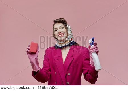 Young Beautiful Woman Professional Cleaner. In The Hands Of Spray And Sponge.