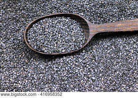 Seeds Of Black Sesame On A Wwoden Spoon.unpeeled Sesame Seeds. Healthy Food. Nature Vitamins.vegan F