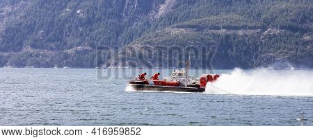 Vancouver, British Columbia, Canada - April 5, 2021: Canadian Coast Guard Hovercraft Riding In Howe
