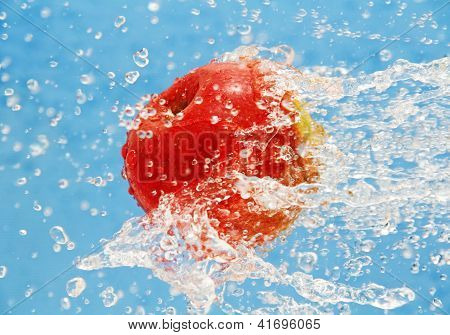 Apple In A Jet Of Water.