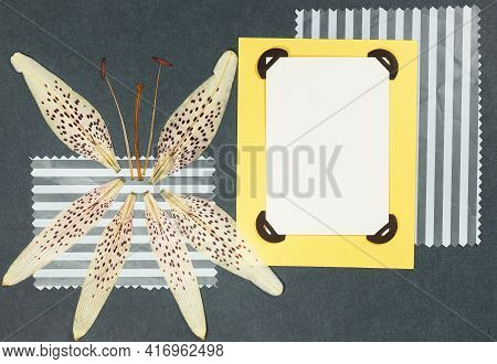 Page From An Old Photo Album. Flowers Lily. Scrapbooking Element Decorated With Leaves, Flowers And