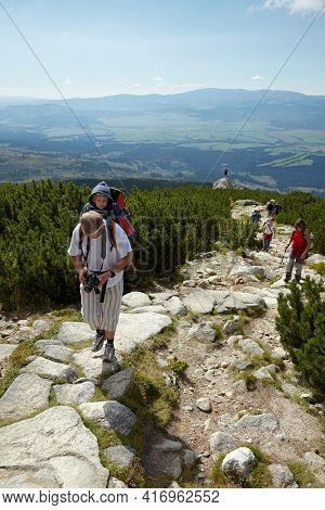 High Tatras, Slovakia - Circa 2010: People hiking on a mountain trail, mountain landscape in the High Tatras, popular destination